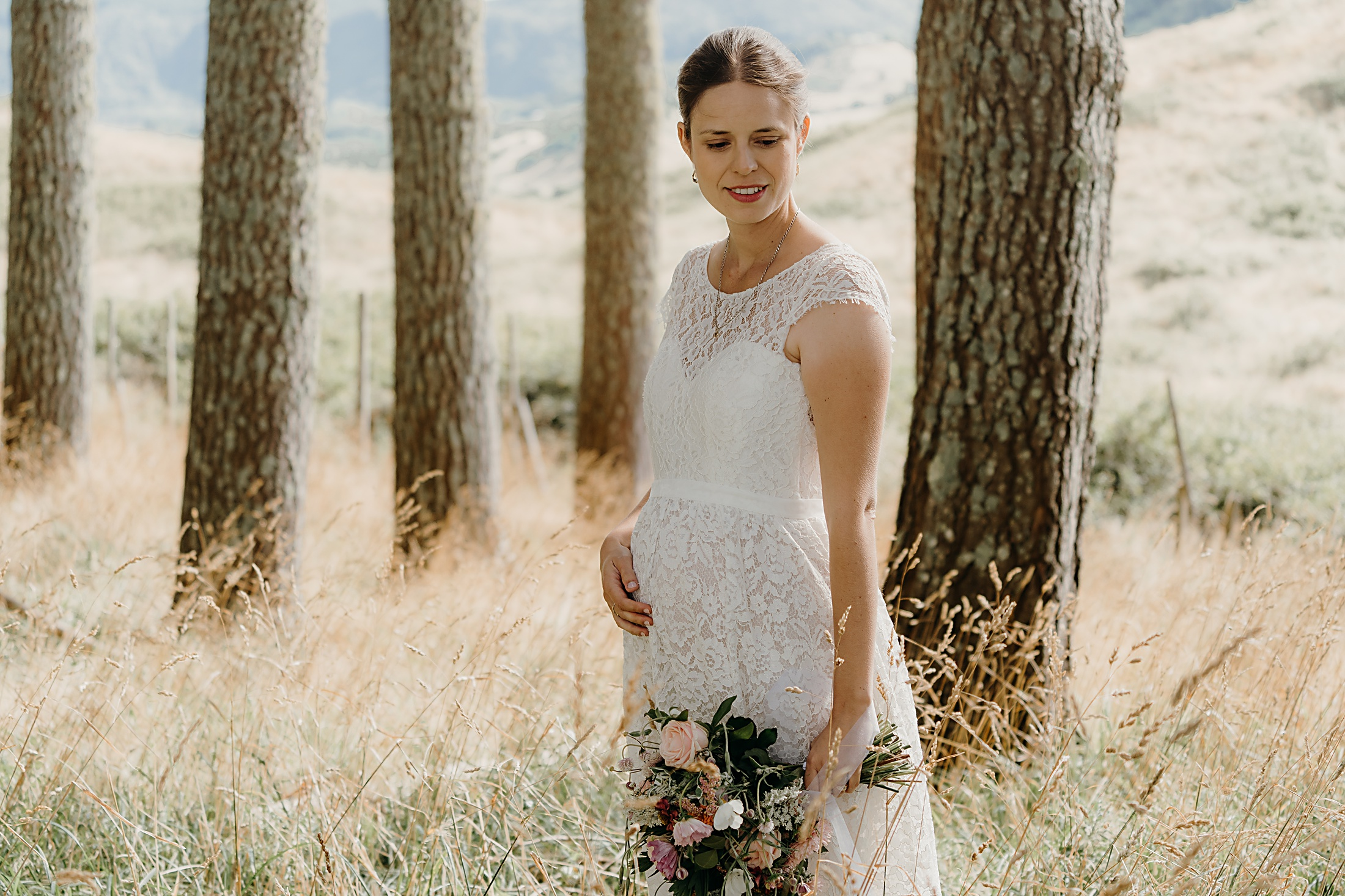 Daisy by Katie Yeung Wedding Dress and pregnant bride
