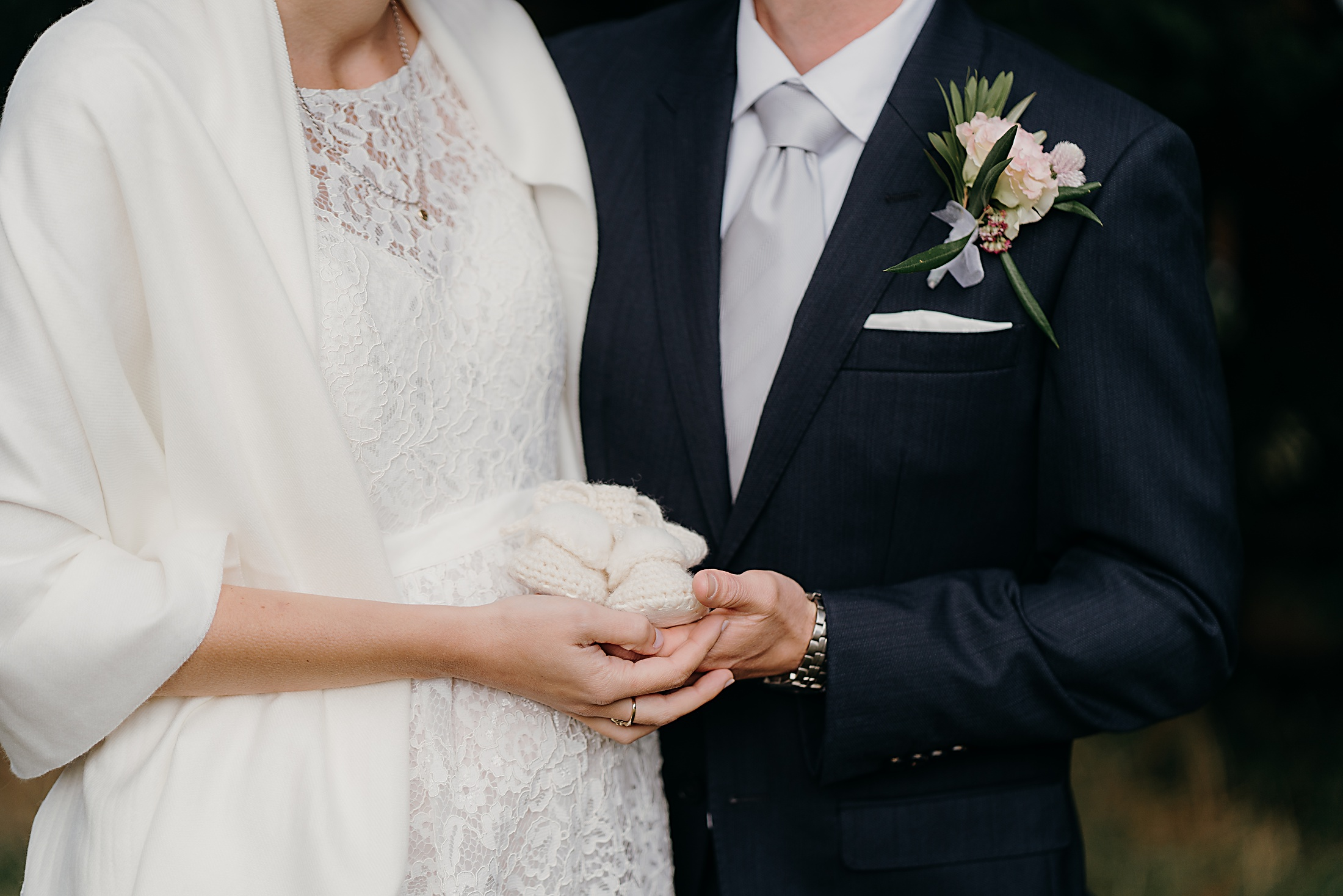 Bride, groom and woollen booties
