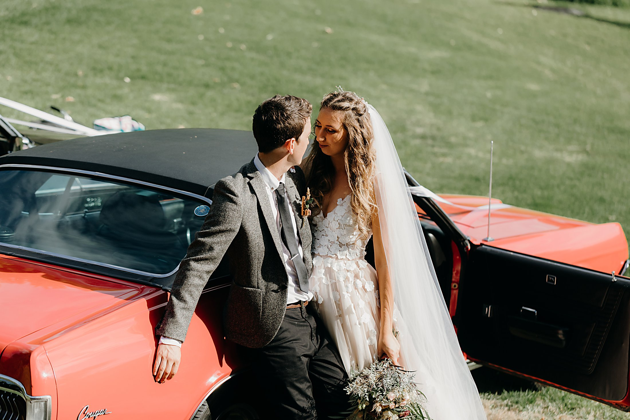 Bride and Groom and wedding car