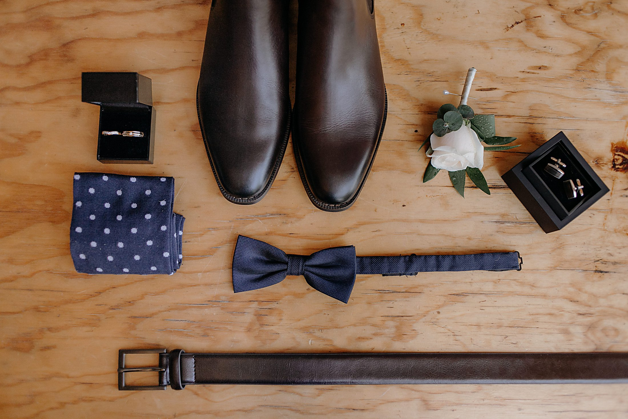 Grooms attire; Navy bow tie, navy spotted socks, brown boots