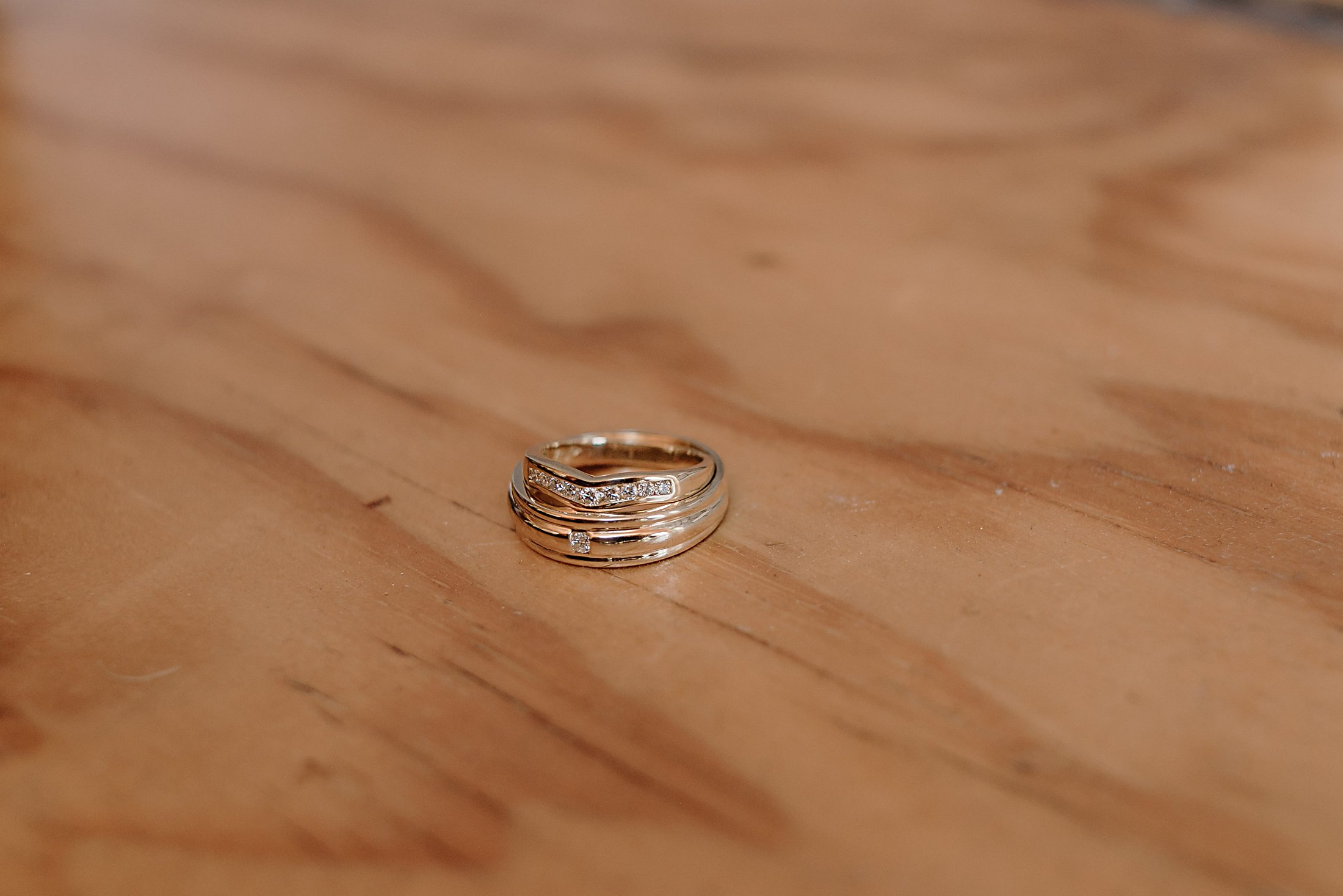 Bride and grooms wedding bands with diamonds