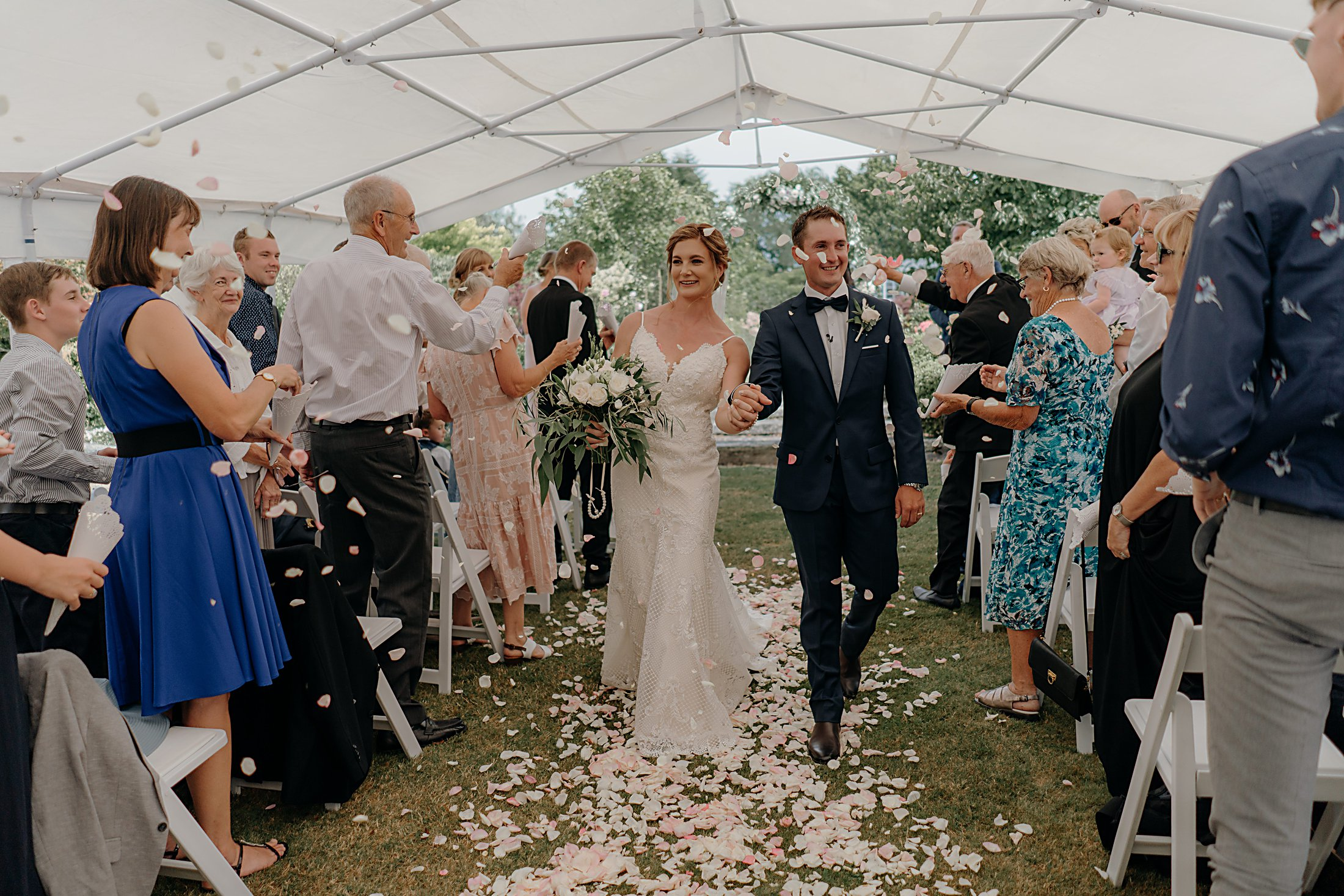 Petal toss as Bride and Groom come back down the aisle