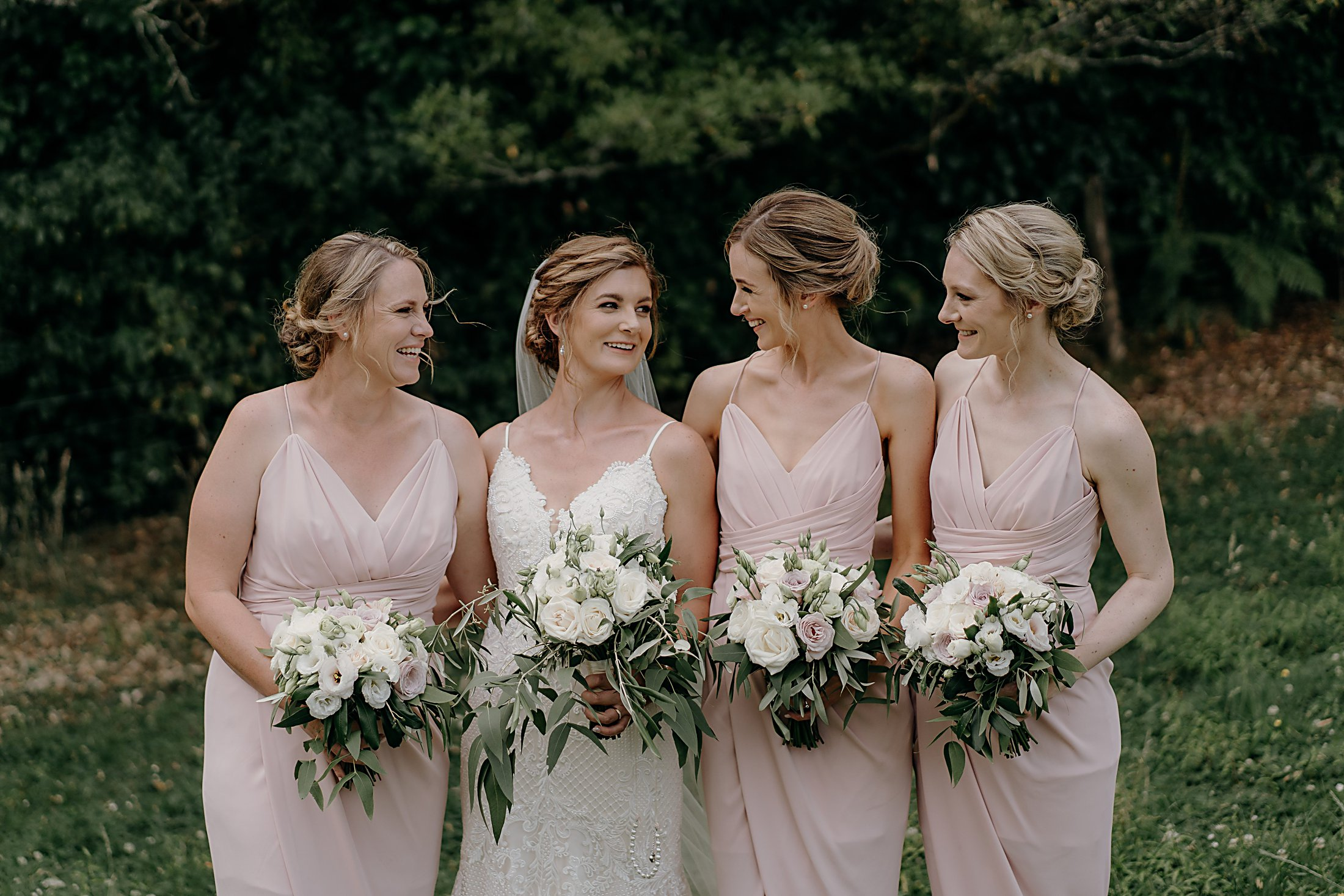 Blush Pink Bridesmaids with white and blush rose bouquets